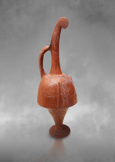 Hittite terra cotta beak shaped long top neck pitcher. Hittite Empire, Alaca Hoyuk, 1450 - 1200 BC. Alaca Hoyuk. Çorum Archaeological Museum, Corum, Turkey. Against a grey bacground.