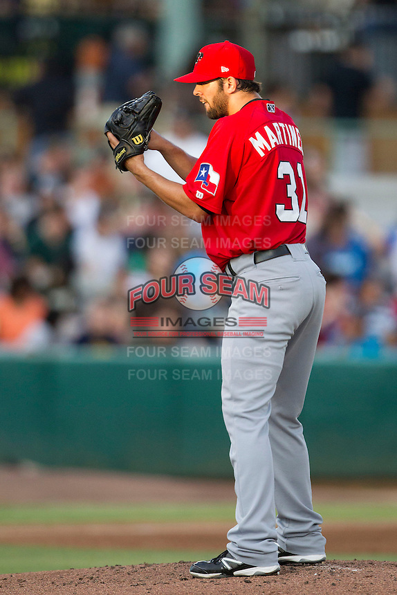 Frisco Roughriders pitcher Nick Martinez (31) looks to his catcher for the sign in the Texas League baseball game against the San Antonio Missions on August 22, 2013 at the Nelson Wolff Stadium in San Antonio, Texas. Frisco defeated San Antonio 2-1. (Andrew Woolley/Four Seam Images)