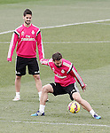 Real Madrid's Isco (l) and Nacho Fernandez during training session.January 30,2015.(ALTERPHOTOS/Acero)
