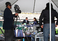 ESPN broadcasters Rob Stone and Julie Foudy. The Houston Dynamo defeated the New England Revolution 2-1 in the finals of the MLS Cup at RFK Memorial Stadium in Washington, D. C., on November 18, 2007.
