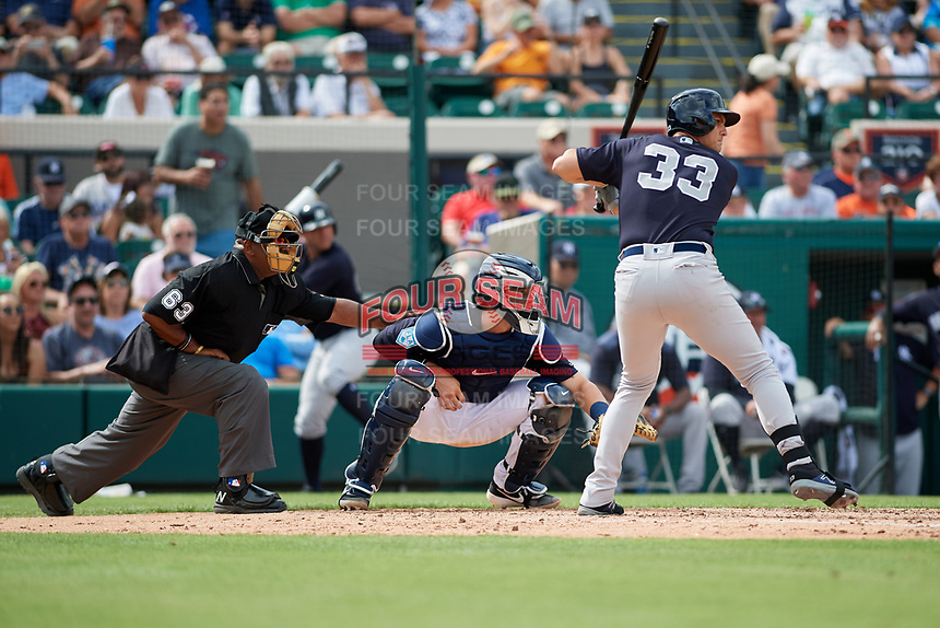 Detroit Tigers catcher Grayson Greiner (17) waits to receive a pitch in front of home plate umpire Laz Diaz as Greg Bird (33) bats during a Grapefruit League Spring Training game against the New York Yankees on February 27, 2019 at Publix Field at Joker Marchant Stadium in Lakeland, Florida.  Yankees defeated the Tigers 10-4 as the game was called after the sixth inning due to rain.  (Mike Janes/Four Seam Images)