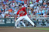 Chris Ellis #10 of the Ole Miss Rebels pitches during Game 4 of the 2014 Men's College World Series between the Virginia Cavaliers and Ole Miss Rebels at TD Ameritrade Park on June 15, 2014 in Omaha, Nebraska. (Brace Hemmelgarn/Four Seam Images)