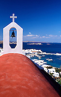 Greece. Mykonos. Greek Orthodox Church and the harbor in Mykonos Town.
