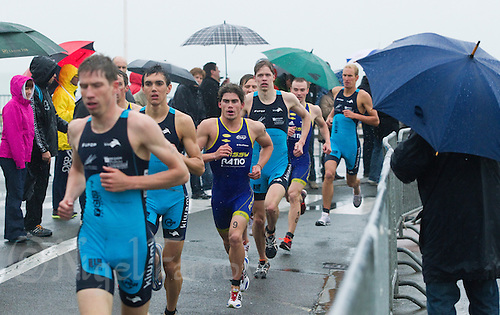 28 APR 2012 - LES SABLES D'OLONNE, FRA - Poissy Triathlon's Come Gilbert (third from left) leads his team mates through the TCC 79 Parthenay competitors during the run of the prologue round of the French Grand Prix Series triathlon in Les Sables d'Olonne, France .(PHOTO (C) 2012 NIGEL FARROW)