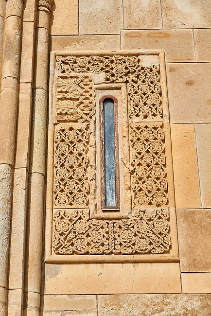 "picture & image of geometric stone work around a window of Samtavisi Georgian Orthodox Cathedral, 11th century, Shida Karti Region, Georgia (country)<br /> <br /> Built during the so called 10-11th century ""Georgian Golden Era"" Samtavisi cathedral is a built in classical Georgian style of the period. Layout on a cruciform ground plan with a high central cylindrical central cupola."
