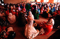 Overview of Indian-Americans as they gather for worship at a Sikh temple. New Jersey.