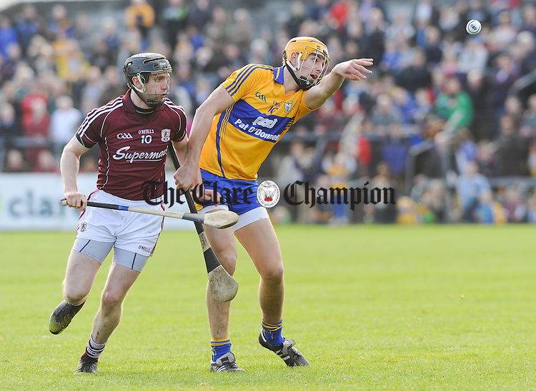 Peter Duggan of Clare in action against Aidan Harte of Galway during their NHL Division 1 Round 5 game at Cusack park, Ennis. Photograph by John Kelly.
