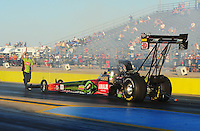 Sept. 23, 2011; Ennis, TX, USA: NHRA top fuel dragster driver Terry McMillen is backed up by a crew member during qualifying for the Fall Nationals at the Texas Motorplex. Mandatory Credit: Mark J. Rebilas-