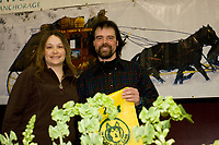Cim Smyth accepts the *Fastest Time From Safety* award from Nome Kennel Club's Cary Miller at the Nome awards banquet during Iditarod 2008