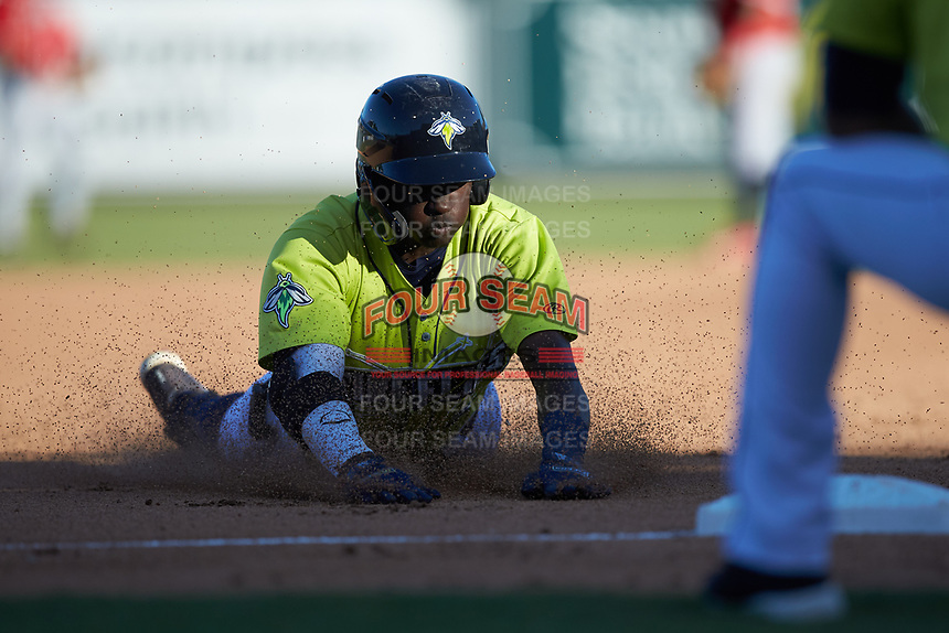 Ronny Mauricio (2) of the Columbia Fireflies slides head-first into third base during the game against the Rome Braves at Segra Park on May 13, 2019 in Columbia, South Carolina. The Fireflies walked-off the Braves 2-1 in game one of a doubleheader. (Brian Westerholt/Four Seam Images)