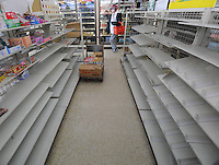 Empty shelves at a small supermaket in Fukushima city, an area, 60 km from the Fukushima Daiichi Nuclear Power Plant. Plant was damaged dring the  Earhquake and following Tsunami that struck Japan on 11th March 2011. With no power or running water and limited supplies of food, people in affected regions are surviving on little food and water, many supermarket stores are queued up with clients buying food and beverages and the stores didn't have many supplies left. .17 Mar 2011