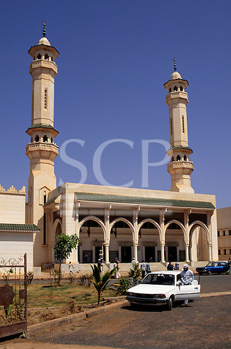 The Gambia. Mosque with steps and twin minarets.
