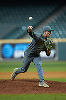 Baylor Bears relief pitcher Daniel Caruso (31) delivers a pitch to the plate against the Arkansas Razorbacks in game nine of the 2020 Shriners Hospitals for Children College Classic at Minute Maid Park on March 1, 2020 in Houston, Texas. The Bears defeated the Razorbacks 3-2. (Brian Westerholt/Four Seam Images)