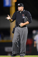Umpire Jeff Gosney explains a a call to Gene Glynn #8 (not pictured) during a game between the Rochester Red Wings and Durham Bulls on May 17, 2013 at Frontier Field in Rochester, New York.  Rochester defeated Durham 11-6.  (Mike Janes/Four Seam Images)