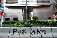 """Graffiti is sprayed on the streets in Central, Hong Kong by protestors. The graffiti reads """"Fuck the popo"""" (pop refers to the police who the protestors believe are eating with excessive force.  Hong Kong has undergone 9 weeks of protests that began with the introduction of an extradition bill allowing criminals to be deported to the legal system in Mainland China but has grown wider into a pro-democracy movement."""