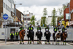 © Joel Goodman - 07973 332324 . 05/05/2012 .  Luton , UK . Metal barriers are erected to block off streets , guarded by mounted police . Approximately 1,500 people take part in an EDL ( English Defence League ) march in Luton , understood to have been policed by over 1,000 officers . Photo credit: Joel Goodman