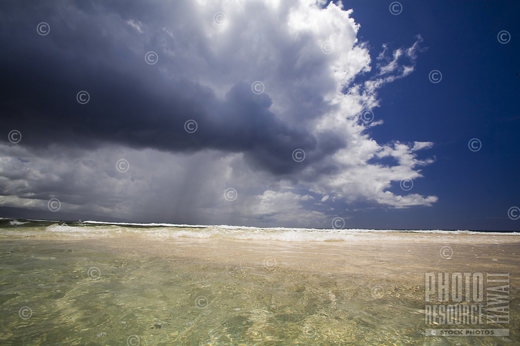 Storm clouds over Rocky Point beach on the North Shore of Oahu