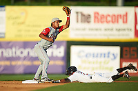 Lowell Spinners second baseman Cleuluis Rondon (5) takes a throw as Tony Kemp (2) slides into second during a game against the Tri-City ValleyCats on July 5, 2013 at Joseph L. Bruno Stadium in Troy, New York.  Tri-City defeated Lowell 5-4.  (Mike Janes/Four Seam Images)