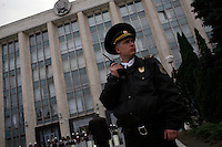 Security forces guard a government building in Chisinau, Moldova on 7 April 2009. Opposition leaders accused the Communists of rigging the elections on 5 April and demanded a recount. Anti-communist rotesters stormed the presidential building, demanding that President Vladimir Voronin announce his resignation and leave Moldova. More than 30 people were injured in the protests.