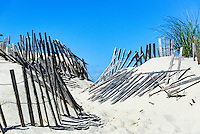 Weathered wind fence along a beach path helps fight wind drift and dune erosion, Truro, Cape Cod, Massachusetts, USA
