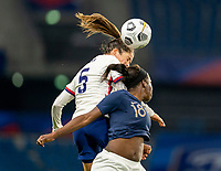 LE HAVRE, FRANCE - APRIL 13: Kelley O'Hara #5 of the USWNT goes up for a header with Viviane Asseyi #18 of France during a game between France and USWNT at Stade Oceane on April 13, 2021 in Le Havre, France.