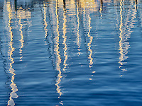 Reflected sailing masts at Monterey Harbor and Marina, California