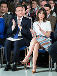 © Joel Goodman - 07973 332324 . 28/03/2015 . Manchester , UK . David Cameron and wife Samantha Cameron sitting ahead of the Prime Minister's speech , at the Conservative Party Spring Forum at the Old Granada Studios , Quay Street , Manchester . Photo credit : Joel Goodman