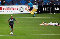 CARSON, CA - APRIL 25: Julian Araujo #2  of the Los Angeles Galaxy moves with the ball during a game between New York Red Bulls and Los Angeles Galaxy at Dignity Health Sports Park on April 25, 2021 in Carson, California.