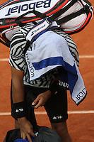 Jo-Wilfried Tsonga, injured, leaving Roland Garros tennis open 2016 on may 28 2016.