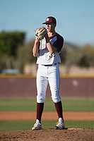 Mountain Ridge Mountain Lions starting pitcher Matthew Liberatore (32) looks to his catcher for the sign during a game against the Boulder Creek Jaguars at Mountain Ridge High School on February 28, 2018 in Glendale, Arizona. Liberatore collected 14 strikeouts in his first appearance of the spring, leading the Mountain Lions to a 6-3 conference victory. (Zachary Lucy/Four Seam Images)