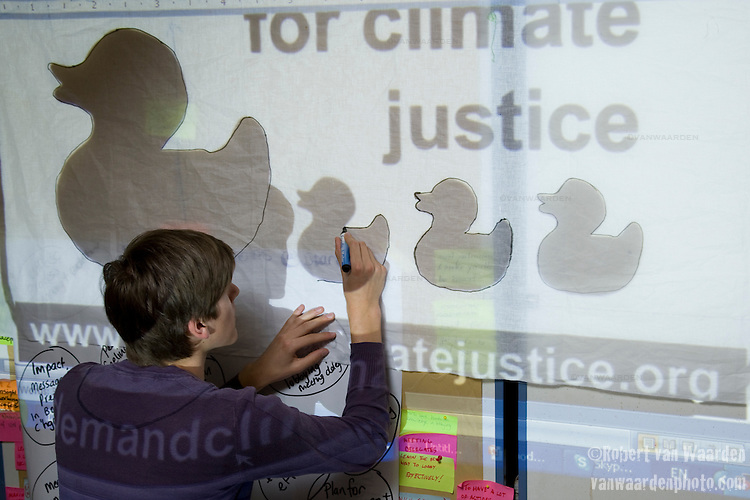 Banner making in preparation for the Day of Action on June 6th at the United Nations Climate Talks in Bonn Germany (©Robert vanWaarden)