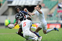 Justin Boyd of the United States is tackled by Paul Albaladejo of France during the iRB Marriott London Sevens at Twickenham on Sunday 13th May 2012 (Photo by Rob Munro)