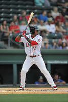 Right fielder Joseph Monge (15) of the Greenville Drive bats in a game against the Columbia Fireflies on Thursday, April 21, 2016, at Fluor Field at the West End in Greenville, South Carolina. Columbia won, 13-9. (Tom Priddy/Four Seam Images)