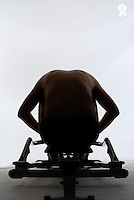 Mature man training on rowing machine, rear view (Licence this image exclusively with Getty: http://www.gettyimages.com/detail/200503010-001 )