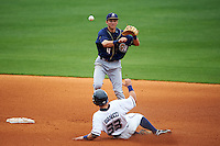 San Antonio Missions shortstop Trea Turner (4) turns a double play as Mike Bianucci (33) slides in during a game against the NW Arkansas Naturals on May 31, 2015 at Arvest Ballpark in Springdale, Arkansas.  NW Arkansas defeated San Antonio 3-1.  (Mike Janes/Four Seam Images)
