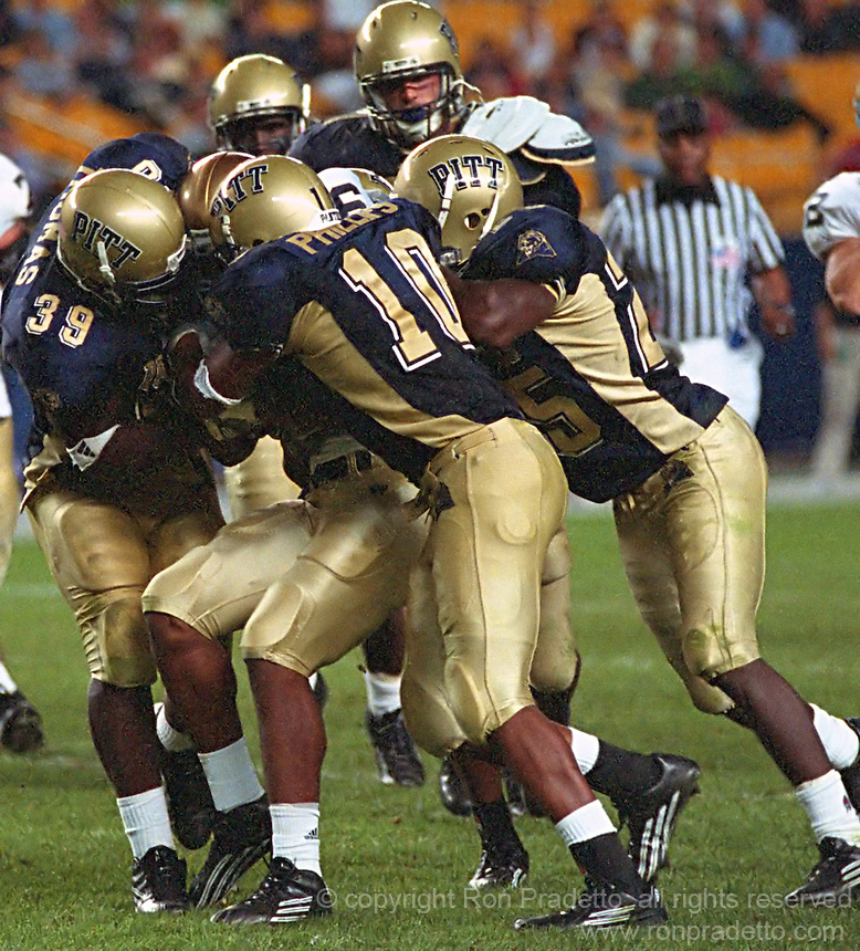 Pittsburgh defense gang tackles a Notre Dame running back on September 3, 2005.