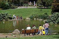 San Francisco, California.  Families at Strybing Arboretum Pond, Golden Gate Park.