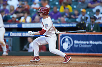 Brady Harlan (21) of the Oklahoma Sooners follows through on his swing against the Arkansas Razorbacks in game two of the 2020 Shriners Hospitals for Children College Classic at Minute Maid Park on February 28, 2020 in Houston, Texas. The Sooners defeated the Razorbacks 6-3. (Brian Westerholt/Four Seam Images)