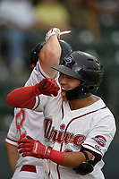 Third baseman Tanner Nishioka (30) of the Greenville Drive is congratulated after hitting a three-run home run during a game against the Lexington Legends on Sunday, September 2, 2018, at Fluor Field at the West End in Greenville, South Carolina. Greenville won, 7-4. (Tom Priddy/Four Seam Images)