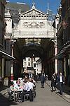 Leadenhall Market City of London EC3 UK. City office workers business men women couple lunch.