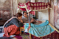 India, Dehradun.  Woman Reading from Sacred Scriptures for Worshipers at the  Sikh Temple built in 1707--the Durbar Shri Guru Ram Rai Ji Maharaj.