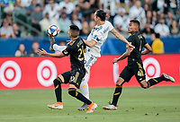 CARSON, CA - JULY 19: Zlatan Ibrahimovic #9 of the Los Angeles Galaxy tips the ball during a game between Los Angeles FC and Los Angeles Galaxy at Dignity Health Sports Park on July 19, 2019 in Carson, California.