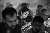 A mother hhugs her child during the pray at the Shri Shri Lokanath Brahmachar Ashram temple at Barodi,  near Dhaka, Bangladesh.