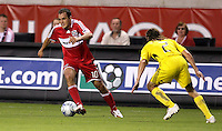 Chicago Fire midfielder Cuauhtemoc Blanco (10) dribbles away from Columbus Crew defender Frankie Hejduk (2).  The Chicago Fire tied the Columbus Crew 0-0 at Toyota Park in Bridgeview, IL on July 11, 2009.