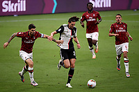 Alessio Romagnoli of AC Milan and Adrien Rabiot of Juventus compete for the ball during the Serie A football match between AC Milan and Juventus FC at stadio San Siro in Milan ( Italy ), July 7th, 2020. Play resumes behind closed doors following the outbreak of the coronavirus disease. <br /> Photo Federico Tardito / Insidefoto