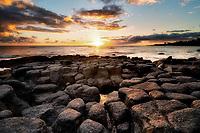 Sunset off coast at Poipu, Kauai, Hawaii.