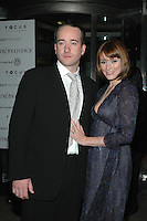 """MATTHEW MacFADYEN & KEELY HOWES.The NY premiere of """"Pride & Prejudice"""" at Loews Lincoln Square Theatre, New York, NY..November 10th, 2005.Photo: Patti Ouderkirk/Admedia/Capital Pictures.Ref: PO/ADM.half length wife married husband hand on stomach blue blacak.www.capitalpictures.com.sales@capitalpictures.com.© Capital Pictures."""