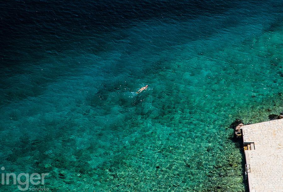 Swimmer off the coast of Kastellorizo, Greece