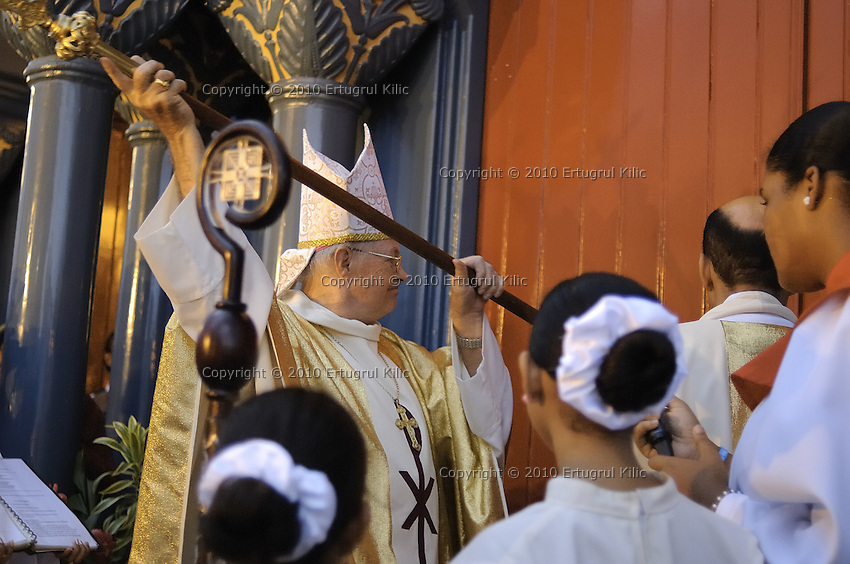 Bishop of Paramaribo Monseigneur Wilhelmus Adrianus Josephus Maria de Bekker knocking the closed doors three times asking for the people of God to be let in.....Blessing and First Worship of ST. Petrus and Paulus Cathedral (AKA World's largest wooden cathedral)