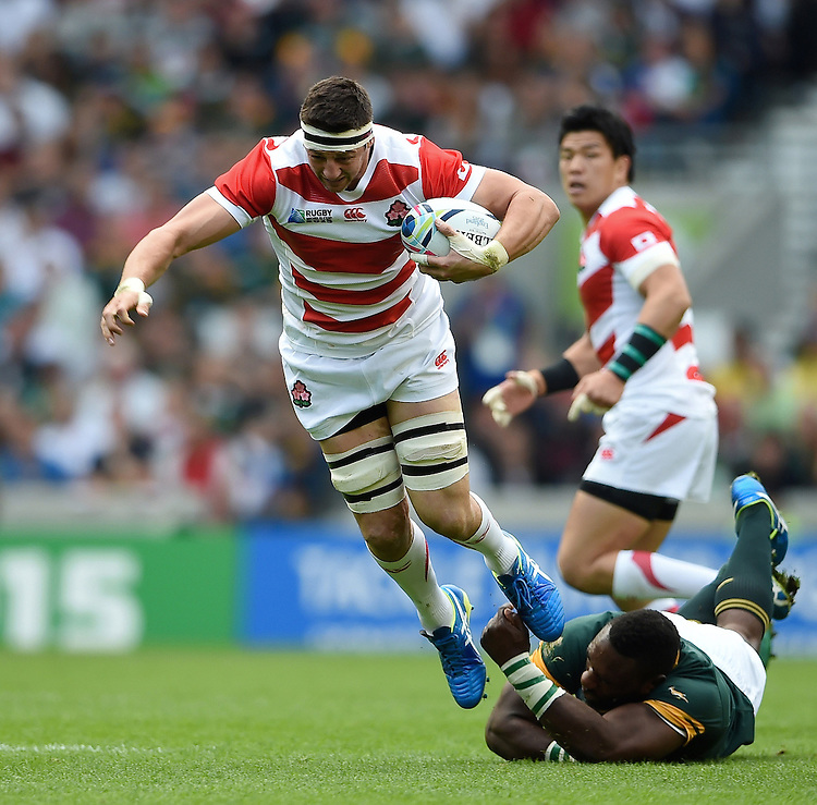 Luke Thompson of Japan escapes the clutches of Tendai Mtawarira of South Africa. Rugby World Cup Pool B match between South Africa and Japan on September 19, 2015 at the Brighton Community Stadium in Brighton, England. Photo by: Patrick Khachfe / Stewart Communications